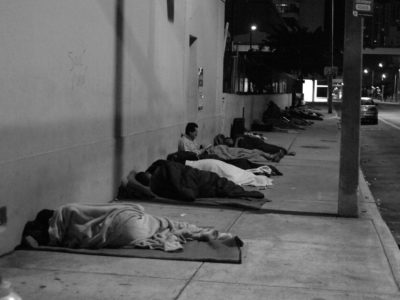 Homeless adults sleeping outside