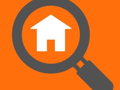 Icon of magnifying glass looking at house