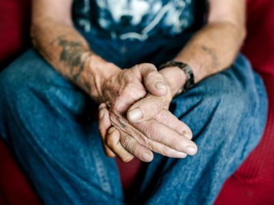 Image of older person's weathered hands