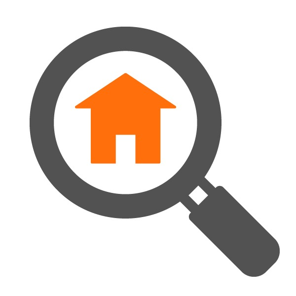 Magnifying glass with house graphic
