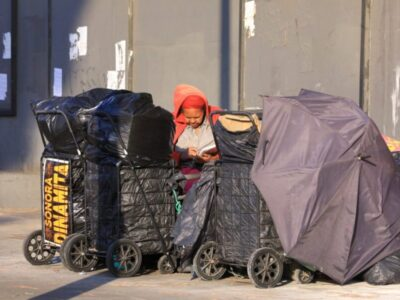 Person on street experiencing homelessness